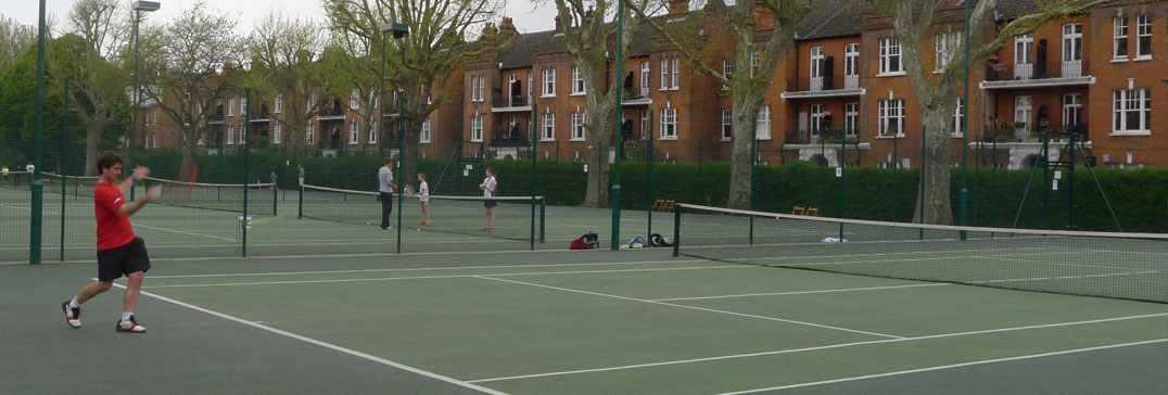 Adult tennis clinic player in Bishops Park, Fulham